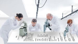 A group of scientists examining a resume and looking for typographical and grammar errorsA group of scientists examining a resume and looking for typographical and grammar errors